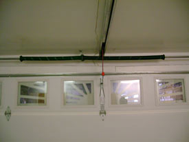 Torsion Springs Are Located Above The Opening Of Your Door With Springs  Slid Onto A Bar. Extension Spring Systems Can Be Found Alongside The  Opening Of The ...